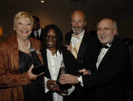 Mary Travers, Whoopi Goldberg, Peter Yarrow, and Paul Stookey