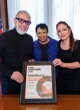 "Dr. Carla Hayden, Librarian of Congress, presents Gloria and Emilio Estefan with their National Recording Registry certificate for their recording ""Rhythm Is Gonna Get You"", which was inducted into the Registry last year. The Estefans were the honorees at last week's Gershwin Prize event at Washington's Constitution Hall."