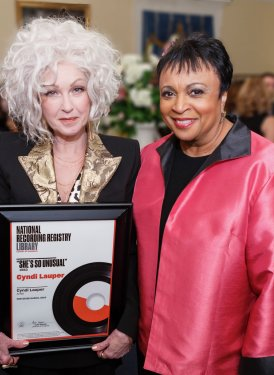 "Dr. Carla Hayden, Librarian of Congress, presents Cyndi Lauper with her National Recording Registry certificate for ""She's So Unusual"", inducted as part of the newly announced Registry ""Class of 2018""."